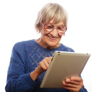 bigstock-Senior-happy-woman-using-ipad--73149421.jpg